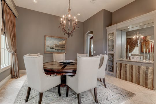 The formal dining area is luxurious and refined.