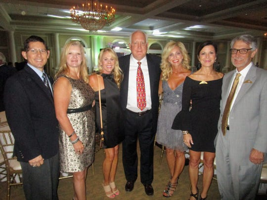 Dave and Cindy Comeaux with members of the Krewe of Bonaparte