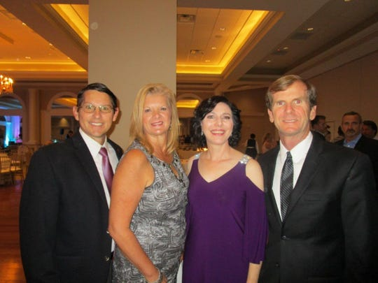 Dave and Cindy Comeaux with Nanette and Joe Heggie at a Krewe of Bonaparte party.