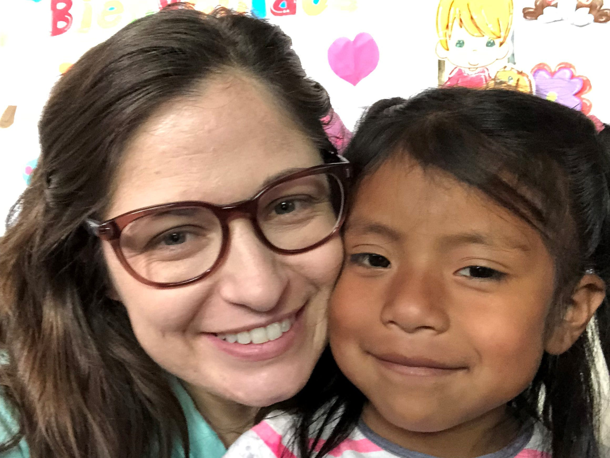 Reporter Leigh Guidry snaps a selfie with a student at an elementary school in Chicoyoj I, a community in rural Guatemala.