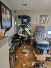 Ryan Aymond snapped a photo of the carnage inside the salon when she went back inside to get her purse. She was sitting in the chair pictured, getting a pedicure.
