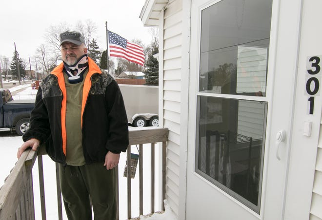 John Roberts, shown Wednesday, Feb. 20, 2019, will be reimbursed property taxes he paid to the seller when he purchased his home at 301 N. Grand St. in Fowlerville after a dispute with local officials.