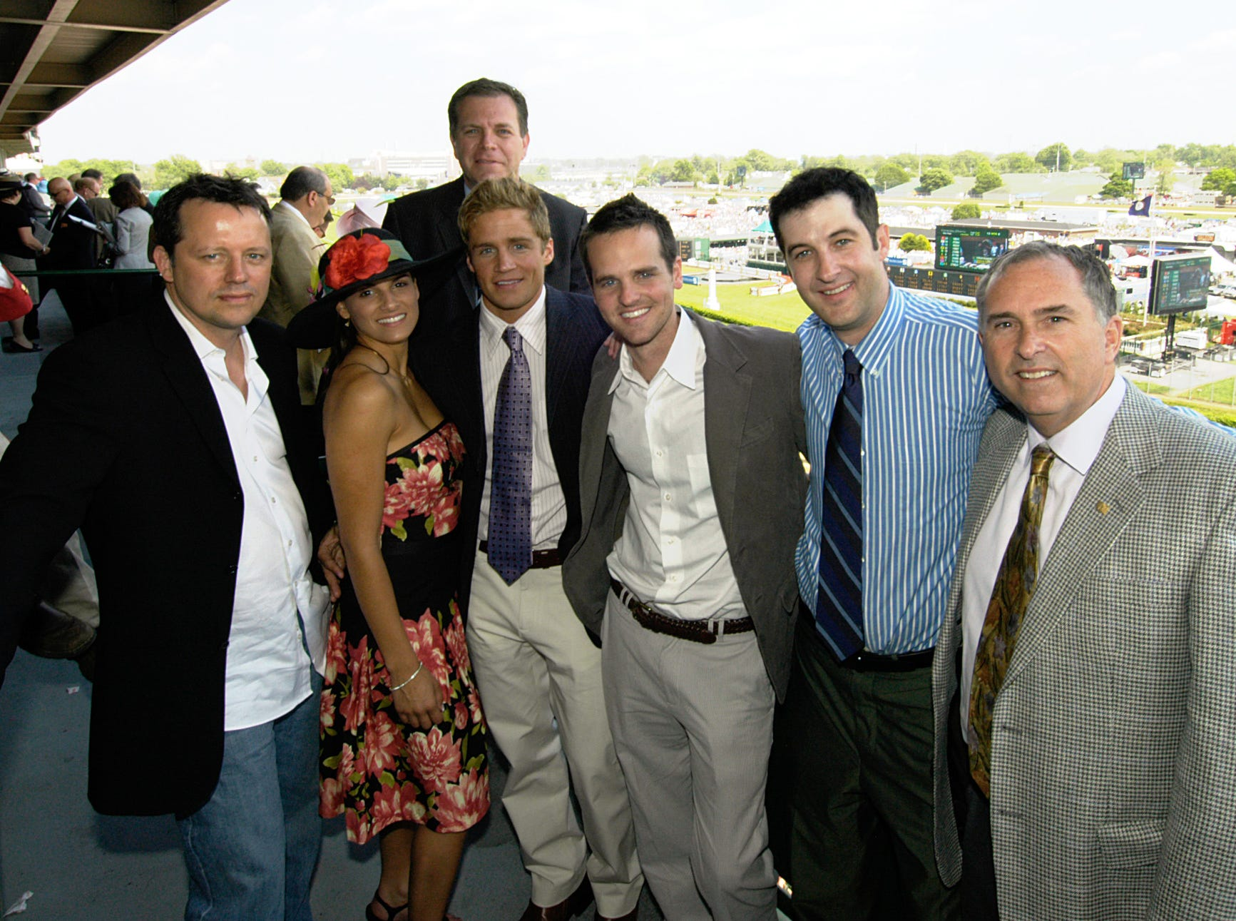 Mike Berry, center/top, president and CEO of Kentucky Derby Festival, at Churchill Downs with Derby Festival guests. May 6, 2006