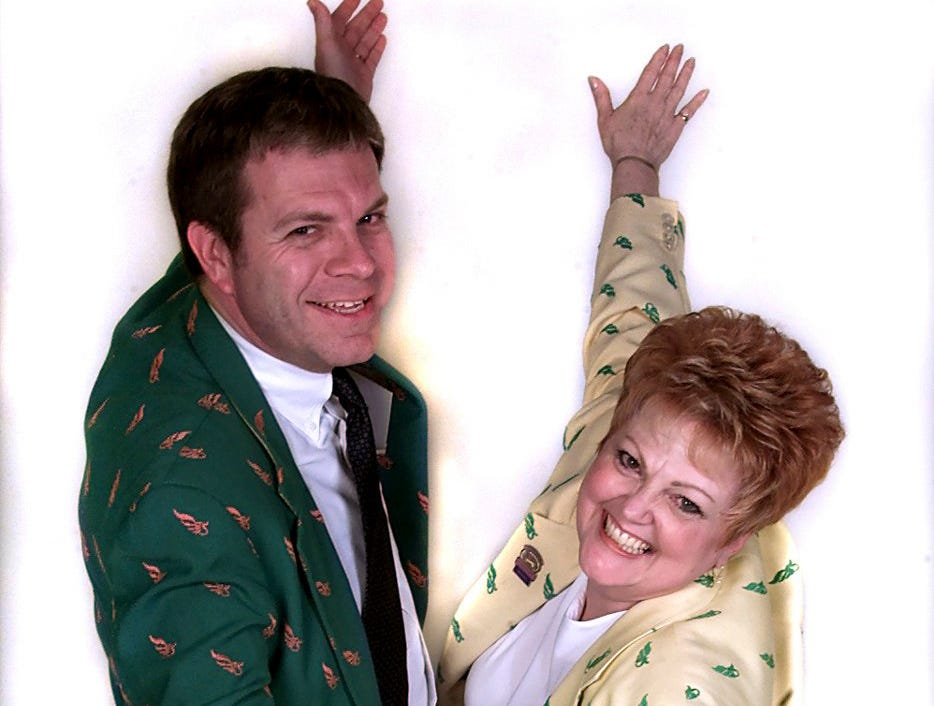Derby Festival President Mike Berry and former Chair Penny M. Stegeman in their green and yellow Derby Festival jackets. April 26, 2000