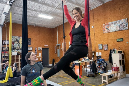 Courier Journal reporter Maggie Menderski takes flight during a class at Suspend Louisville.