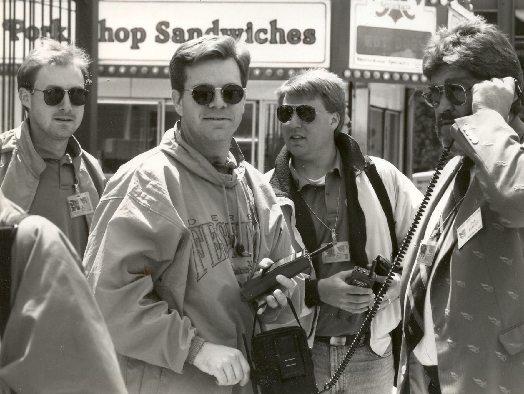 "Kentucky Derby Festival managers were dealing with bad weather in 1994 at the Chow Wagon. From left to right: John Reisert, event manager; Mike Berry, vice president and managing director; Tom Elpers, director of events; Dan Mangeot, president and CEO. ""We all look like Secret Service in our Ray Bans,"" Berry later said. Mike took over leading the Festival after Dan died unexpectedly in February 1997."