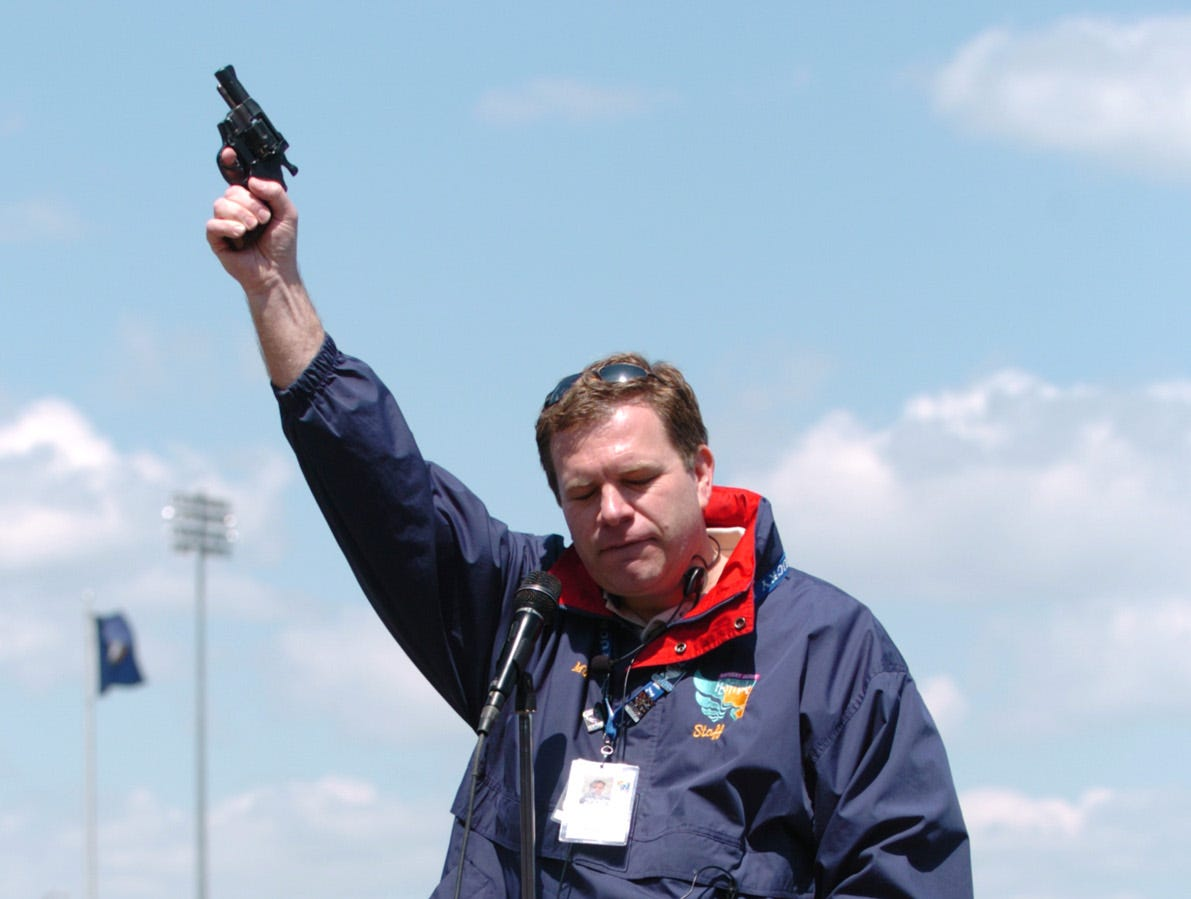 Mike Berry, president and CEO of the Kentucky Derby Festival, fires a starter's pistol to begin the Run for the Rosé in April 2004.