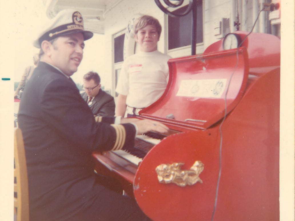 A young Mike Berry checks out the calliope player aboard the Delta Queen in May of 1972.