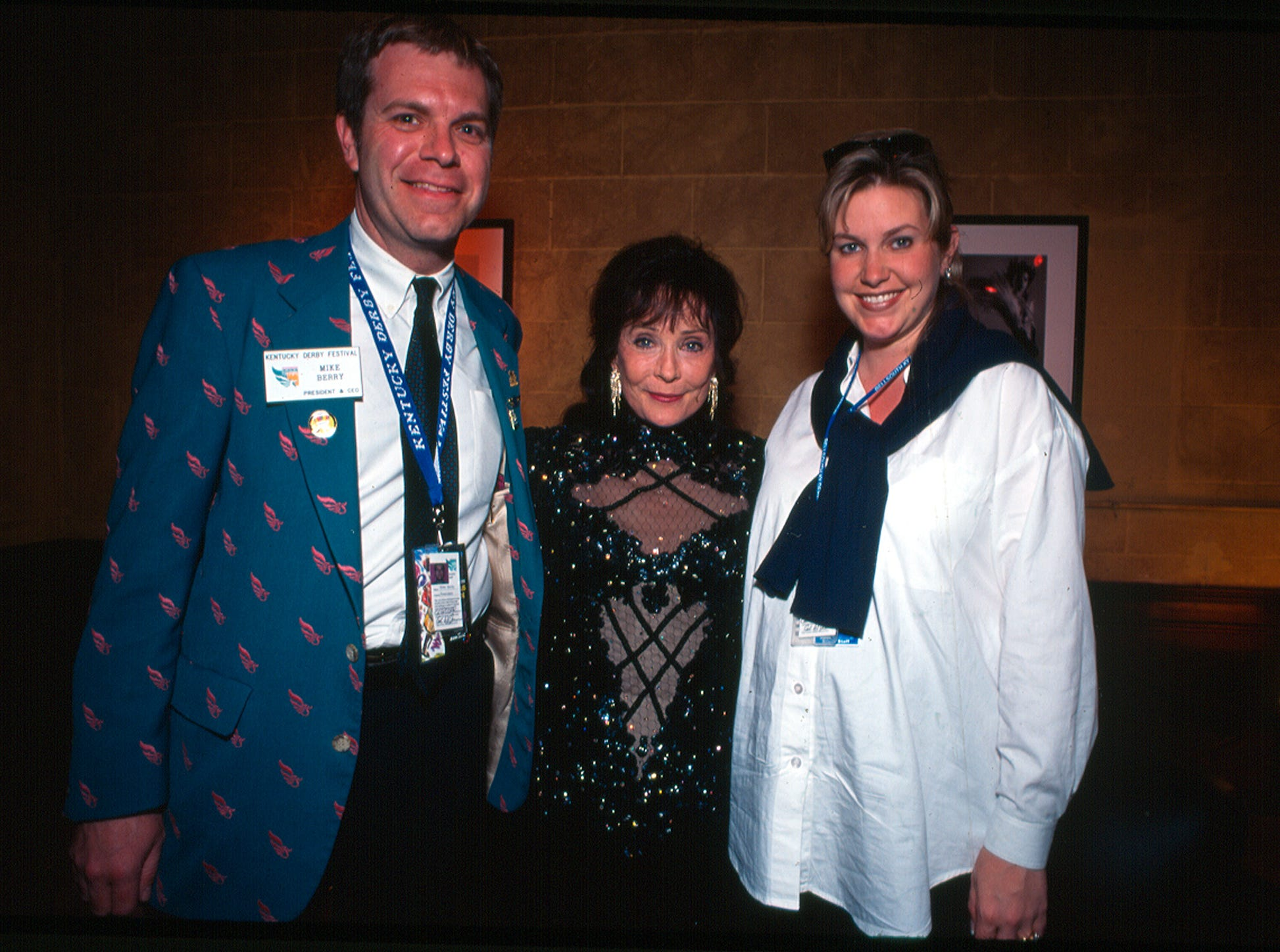 Mike Berry pictured with Loretta Lynn, center, and Stacey Yates, former vice president of communications for KDF, in 1999. Berry is retiring as KDF's president and CEO in 2019.