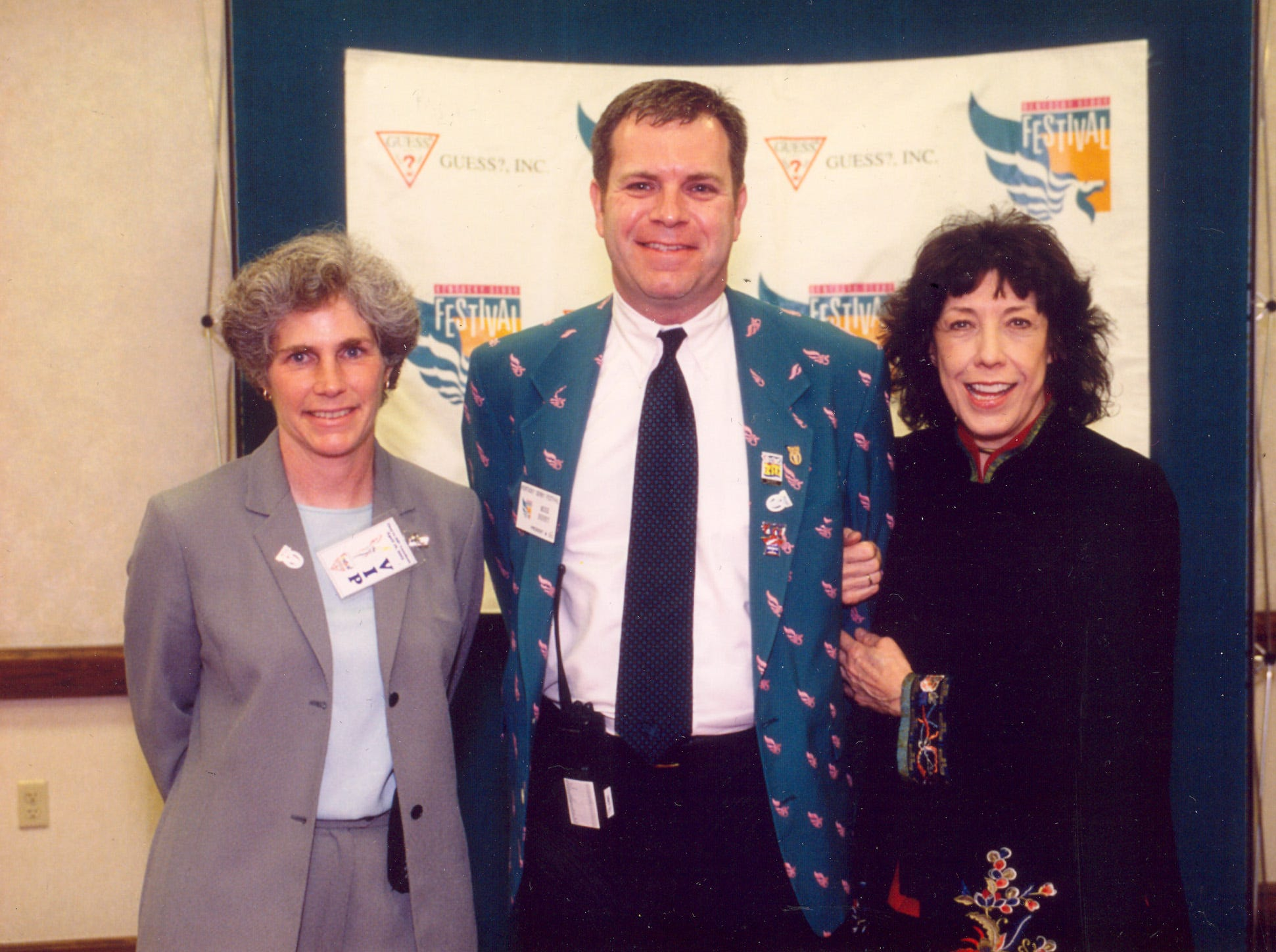 Mike Berry pictured with Lily Tomlin, right, and his sister, Marsha Berry, left, in 2002 at the They're Off! Luncheon.