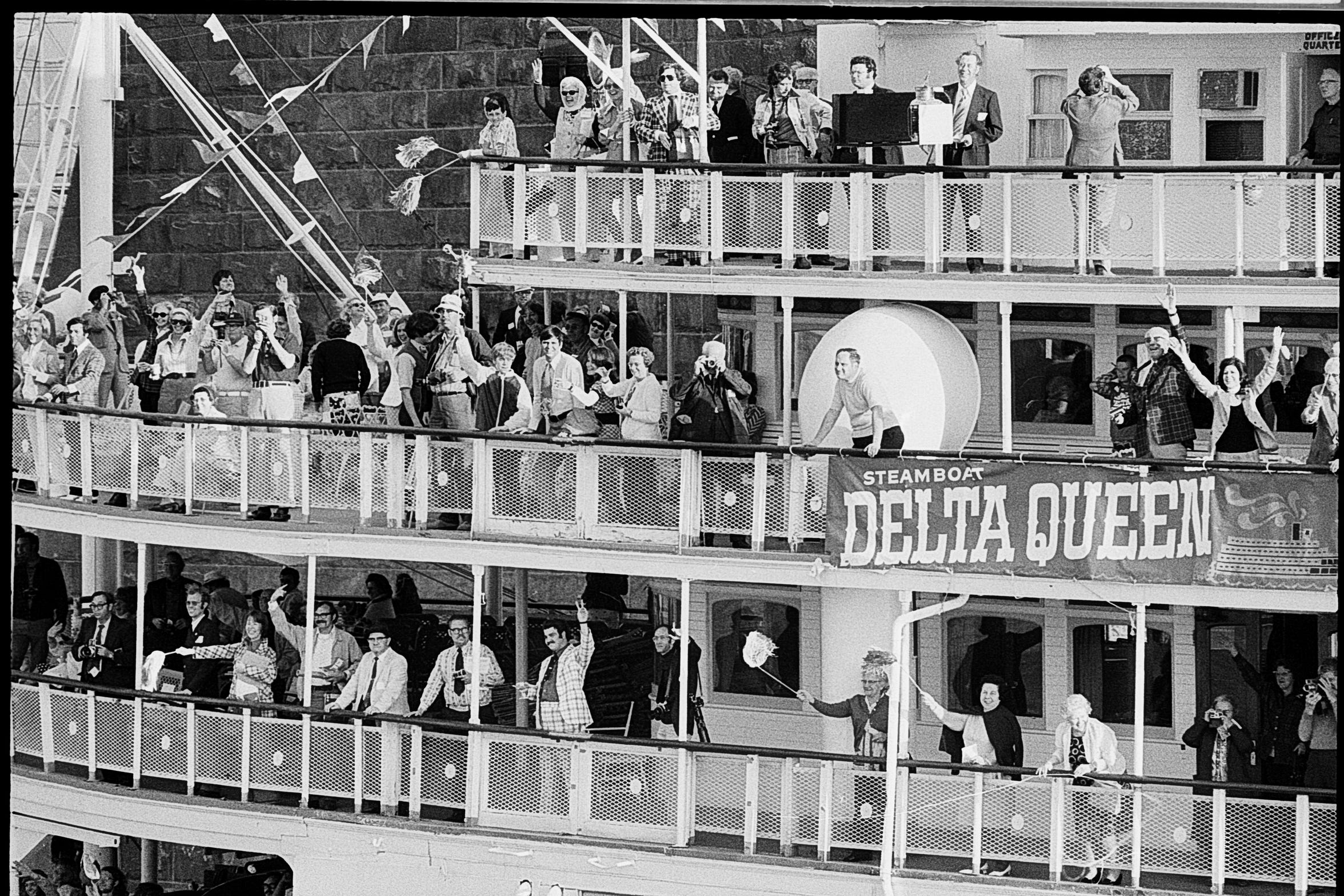 The Delta Queen returned to the Fourth Street wharf after a victorious race against the Belle of Louisville. A young Mike Berry can be seen waving a pom pom on the middle deck in a two-tone jacket. May 2, 1973