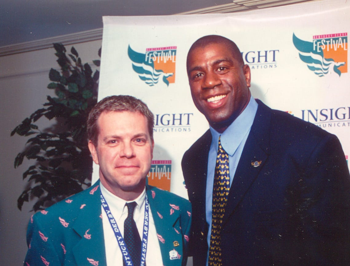 Mike Berry, retiring president and CEO of Kentucky Derby Festival, pictured with Magic Johnson in 2000 at the They're Off! Luncheon.