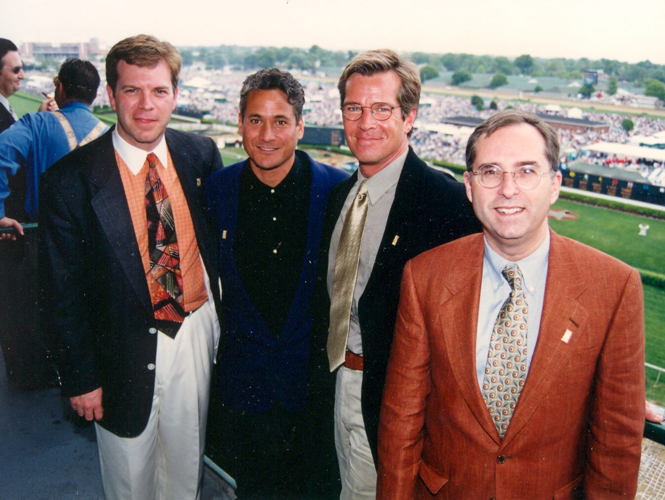 Mike Berry, left, at Churchill Downs with Derby Festival guests.