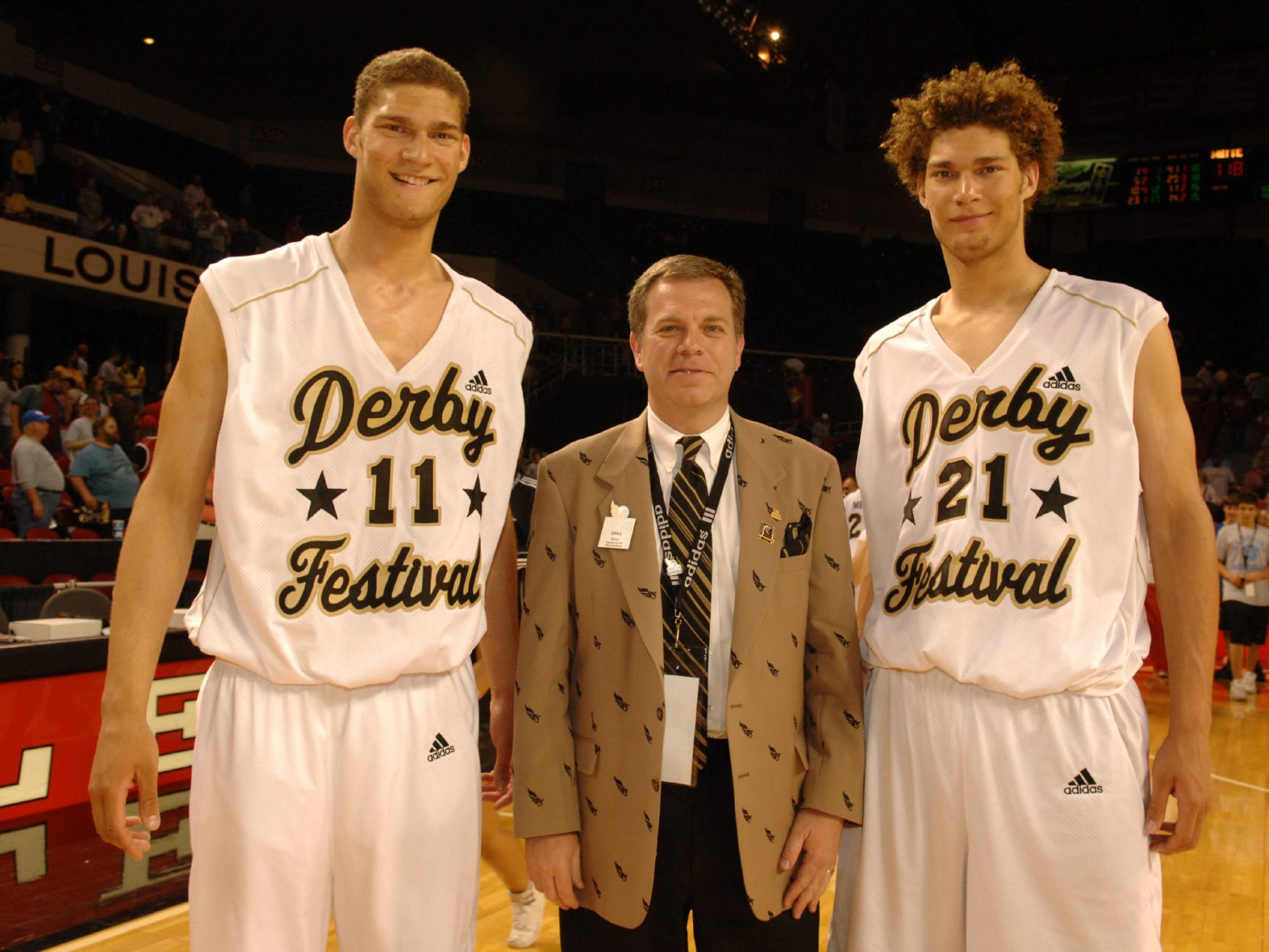 Mike Berry pictured with Robin Lopez and Brook Lopez at the Kentucky Derby Festival Basketball Classic in 2006.