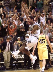 Mateen Cleaves leaps for joy after passing for an assist to teammates for a Spartan basket late in Saturday's Big Ten Championship-clinching victory over Michigan on Mach 4, 2000.