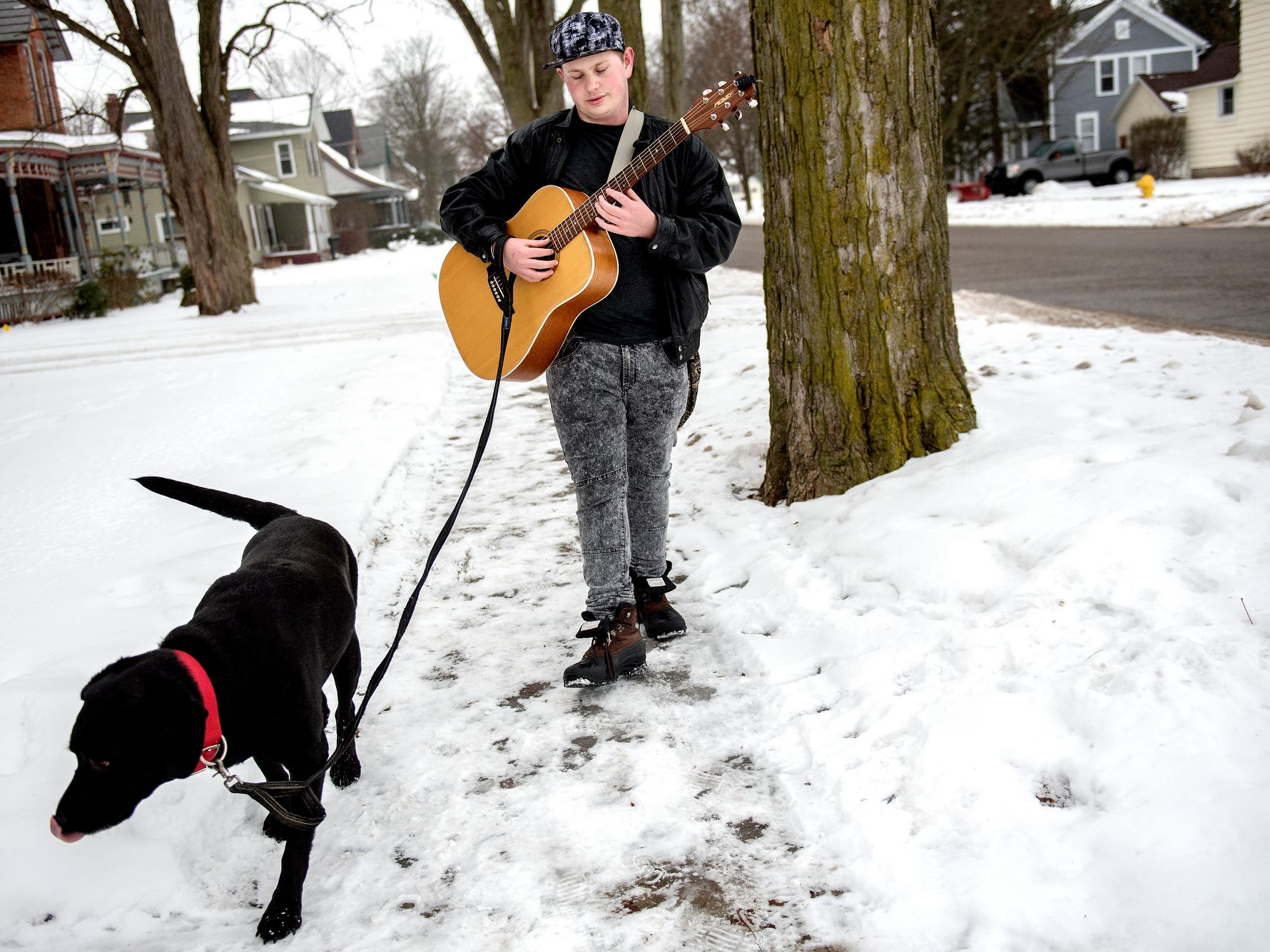 Photos: Charlotte's 'singing dog walker,' Garrett Blocker, fights stigma with music
