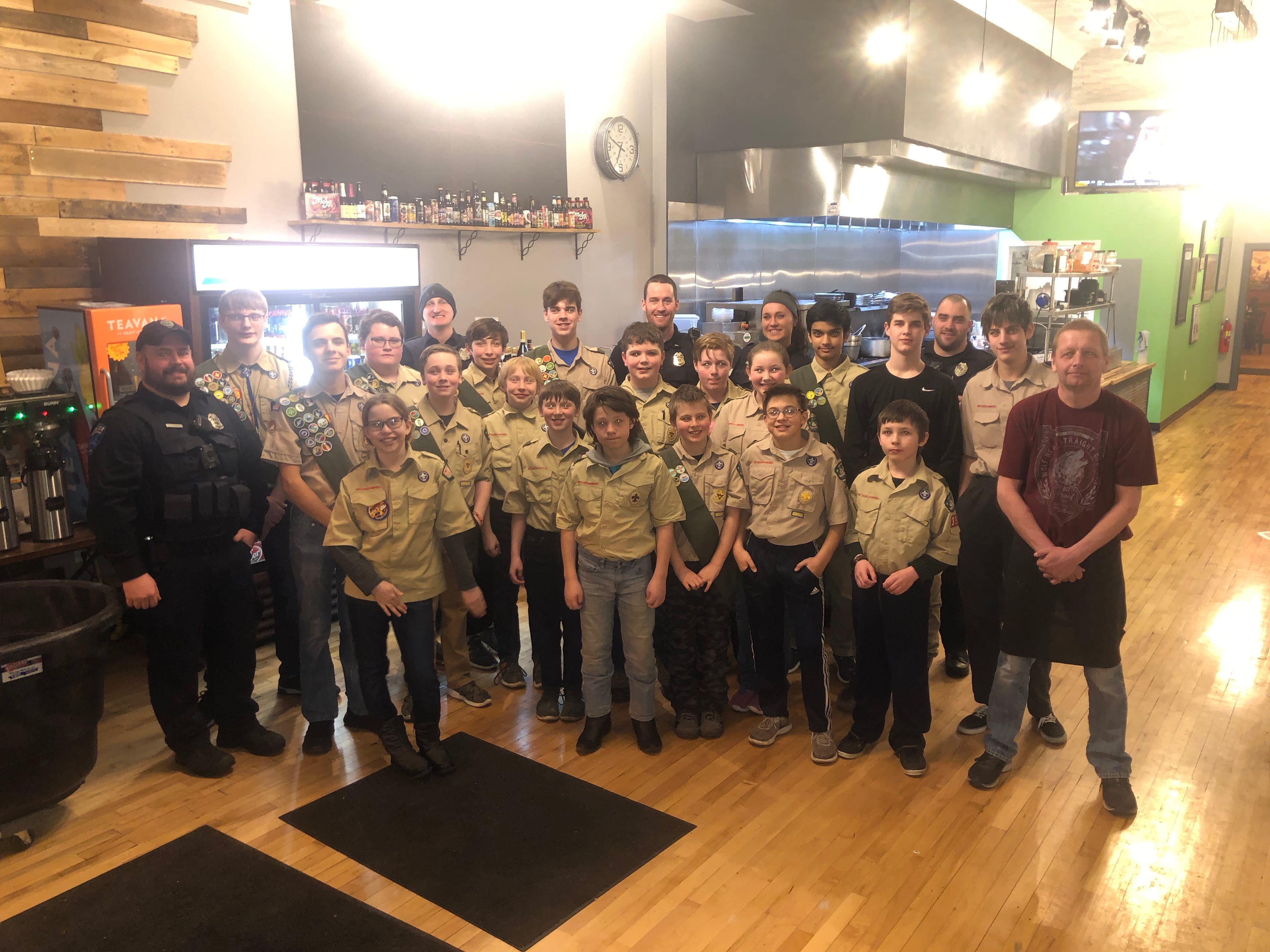 Scouts had a chance to visit with Marshfield police officers. Some of the participants posed for a picture after the meal.