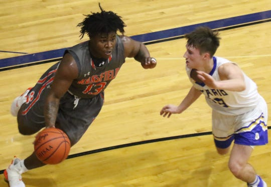 Mansfield Senior's Quan Hilory is guarded by Ontario's Griffin Shaver, two of the best players in the Division II Madison District Tournament.