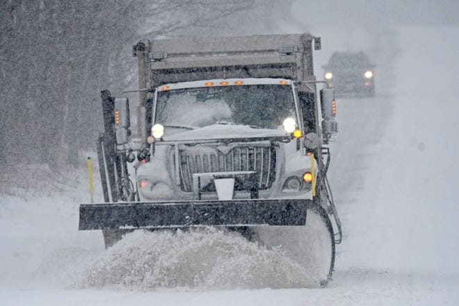 An Ohio Department of Transportation snow plow driver clears a section of Ohio 96 as a following motorist enjoys the cleared path behind him in this file photo from February 2019. The first major storm of the winter is forecast for Richland County Monday and Tuesday.