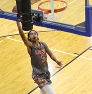 Mansfield Senior's Roger Merrell III drives for a breakaway lay-up in the Tygers' 52-49 win over Ontario on Tuesday night.