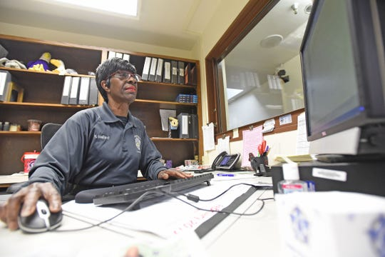 Nettie Ballard works the second floor Mansfield Police Station information desk and is retiring Feb. 28 after more than 30 years with the department.