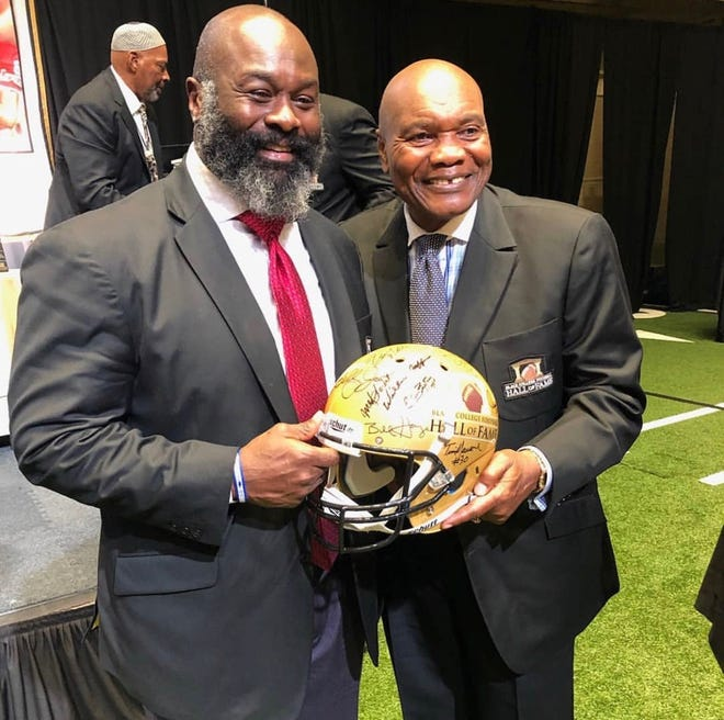 Mansfield Senior grad and former NFL star Hugh Douglas with his college coach at Central State, Billy Joe. Douglas was inducted into the Black College Football Hall of Fame during ceremonies in Atlanta.