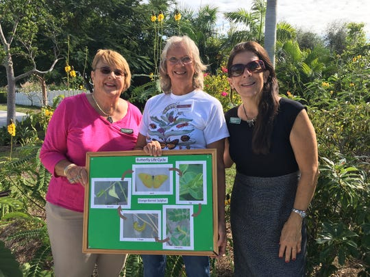 Donna Kay, Sue Oldershaw and Susan LaGrotta talk to tour group about life cycle of a butterfly at Calusa Park Butterfly Garden.