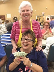 Claire Parker, with Bingo Committee member Shirley Posner, was the big winner at Monday Night Bingo held every week at the Jewish Congregation of Marco Island.