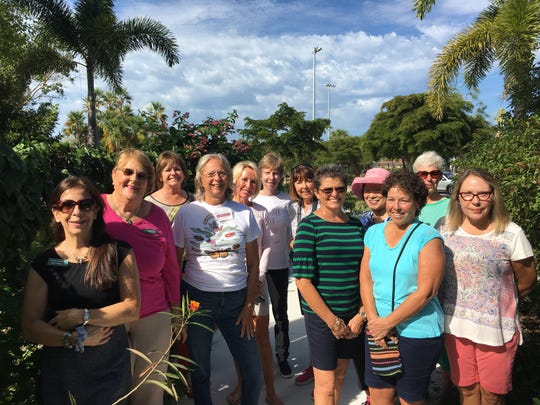 Front, from left, Susan LaGrotta, Sue Oldershaw and Dona Kay with a community group touring Calusa Park Butterfly Garden.