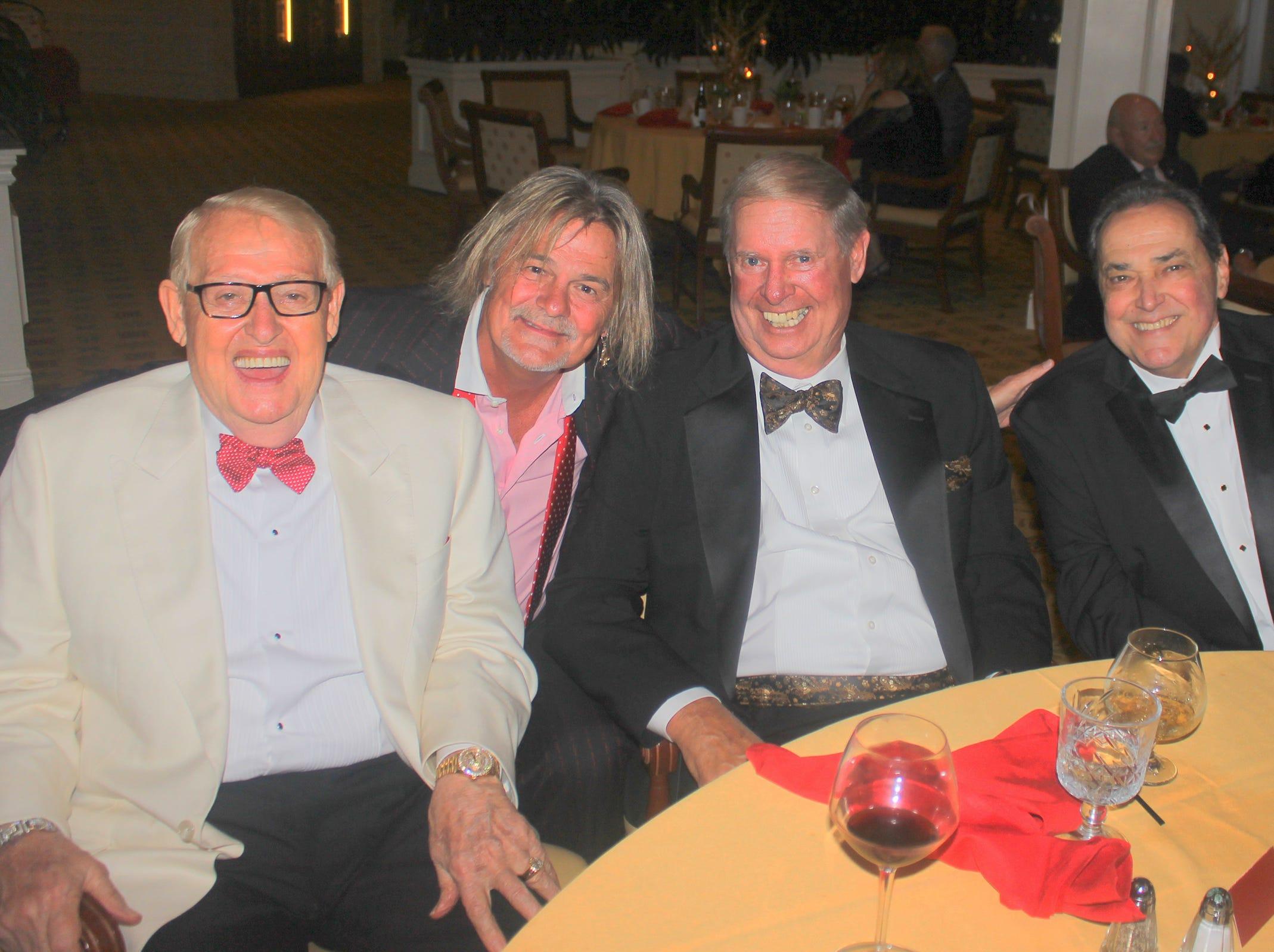 Taking a break from the dance floor are Tony Wolfe, Dan Wolfe, Ray Seward andTom Kraemer.