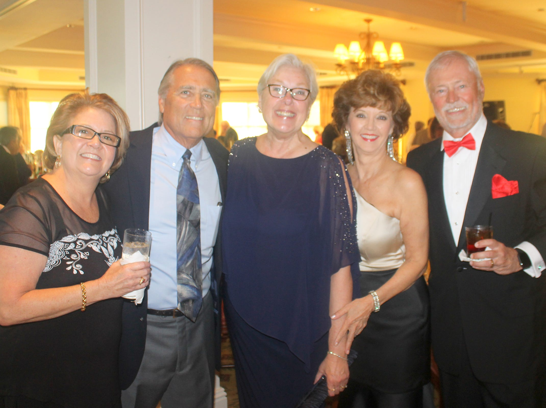 Debbie and Bill Schroeder, Jackie Dywan, Candy Seward and Bill Rogers like to party.