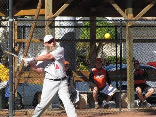 Dan Marinelli of Sand Bar is about to line the ball for base hits against the Brewery.