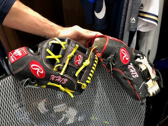 Mauricio Dubon said his gloves have pink initials and a birth date as a nod to his girlfriend, Nancy.