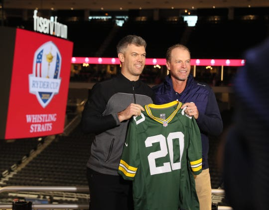 Green Bay Packers kicker Mason Crosby (Ieft) presents a jersey to Steve Stricker, who was named captain for the 2020 U.S. Ryder Cup team Wednesday at Fiserv Forum.