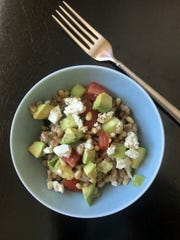 Farro salad can use any grain. Toss with vinaigrette and veggies, and top with avocado and goat cheese and lunch is yours.