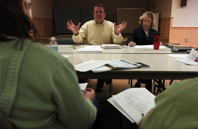 Don Schwartz (center), president of the Friends of the Hales Corners Pool, discusses operations of the pool in this 2008 file photo. A recent audit found the park group lacked transparency and had several potential conflicts of interest in its dealings.