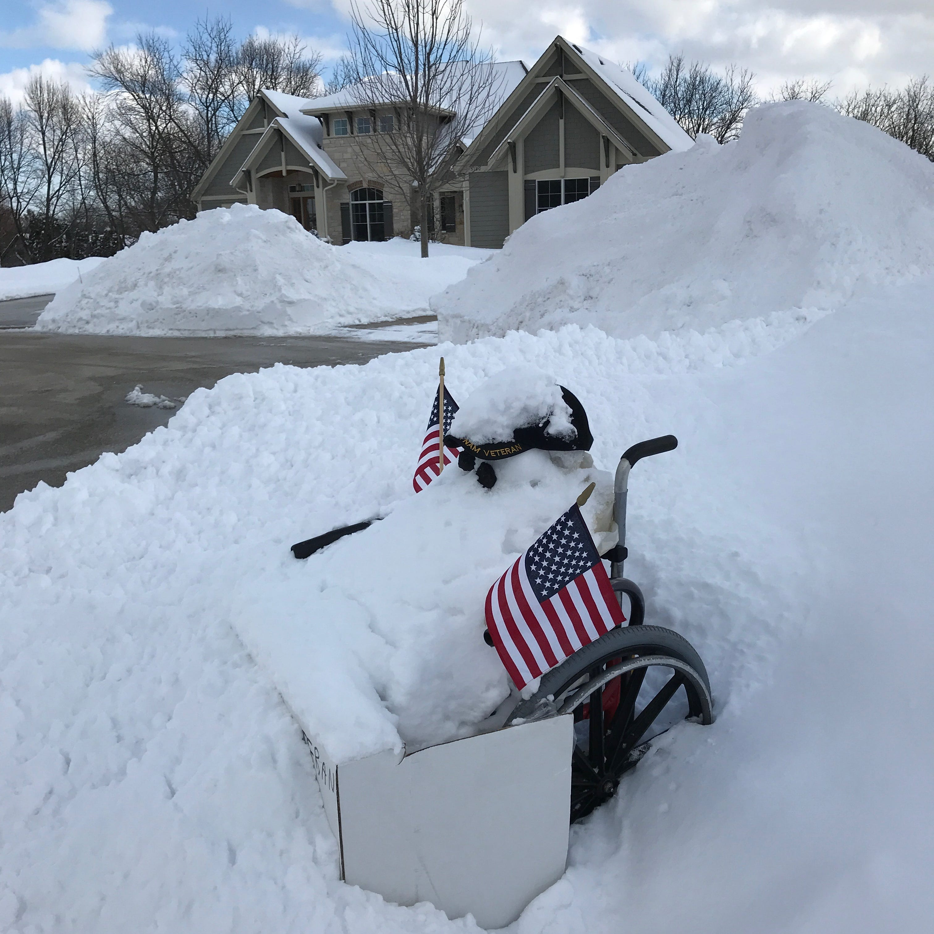A paralyzed Hales Corners man can't get around the snow blocking his driveway. The village says it can't help.