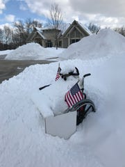 LuAnn and Phil Bird constructed this wheelchair-bound snowman to warn a Hales Corners plow driver not to block their driveway with snow, because it limits the access of Phil, a paralyzed war veteran. It didn't work.