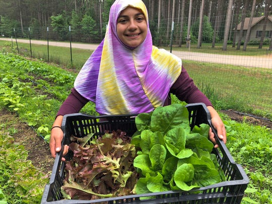 Selling home-baked goods has allowed Alicia Razvi to double the income generated by her family's Wooly Thyme Micro Farm near Stevens Point. Shown here is her daughter, Aaliyah Razvi, 13.