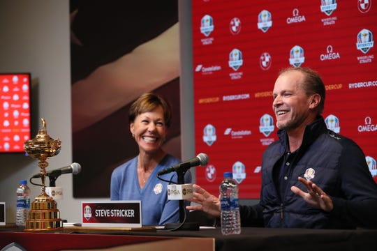 Steve Stricker (right) answers questions after being introduced as the U.S. captain for the 2020 Ryder Cup at Whistling Straits.  At left is Suzy Whaley, President of the PGA.  The event was held at the Fiserv Forum in Milwaukee.