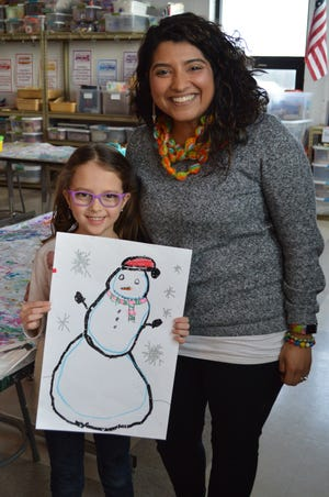 """Briella Honeck, a first grader at Cedar Hills Elementary, was named an """"Artist of the Week"""" on Artsonia, an online art museum made up of 65 million student works. Sabrina Weiland, art and design educator at Cedar Hills, has been using Artsonia for 11 years."""