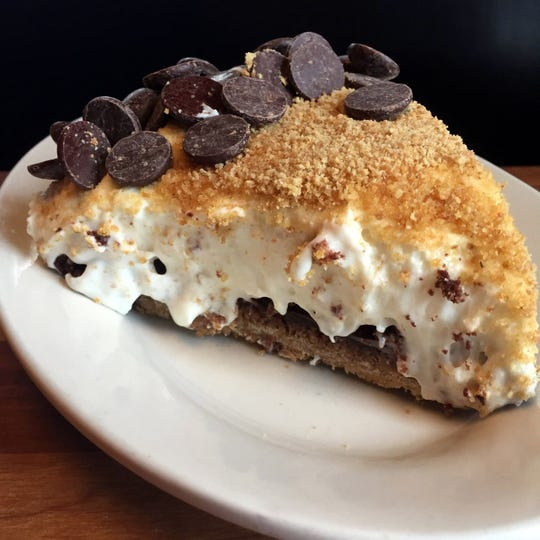 S'Mores Pie offers four layers of rich, creamy, chocolaty goodness, topped with graham cracker crumbs and chocolate pieces.