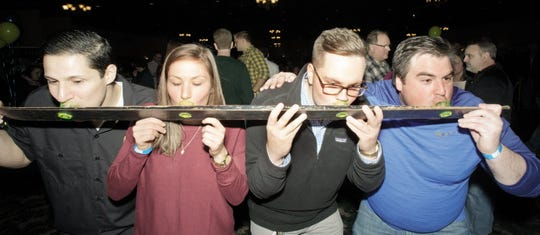 (From left) Sal Fadel, Danielle Snyder, Cole Russell and Tom Stapleton take a shot of tequila from Mi Cosecha Tequila at a previous Oconomowoc Brewfest.