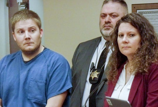 Brian Campbell (left) appears in Dane County court in Madison, Wisconsin with his lawyer, Sarah Schmeiser. The photo is from a 2018 court appearance.
