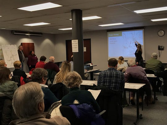 Washington County residents listen to a presentation from Sonia Haeckel, a project planner with Toole Design, at a February open house on the Washington County Bike & Pedestrian Plan. The meeting was standing room only.