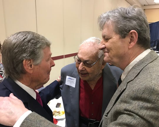 U.S. Sen. John Kennedy, right, visits with World War II veteran John Willard, 93, center, and state Sen. Francis Thompson, D-Delhi, in Monroe Wednesday.