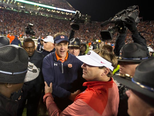 Auburn head coach Gus Malzahn greets Georgia head coach Kirby Smart after the Deep South's Oldesr Rivalry on Nov. 11, 2017, in Auburn, Ala.