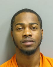 Gerrod Scott was charged with two counts of domestic violence and one count of burglary.