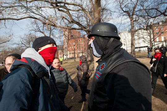 Members of a right wing group (R) clash with Antifa members during the 2019 Women's March at Boston Common in Boston, Massachusetts, January 19, 2019. (Photo by Joseph PREZIOSO / AFP)        (Photo credit should read JOSEPH PREZIOSO/AFP/Getty Images)