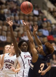 Pike Road's Jonsheria Clement (3) goes up for a layup during the Class 3A southeast regional championship at Garrett Coliseum in Montgomery, Ala., on Wednesday, Feb. 20, 2019. Montgomery Academy leads Pike Road 21-44 at halftime.